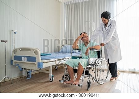 The African American Doctor Is Pushing The Wheelchair And Provide Consultation Regarding Treatment T