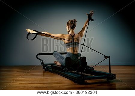 The Reformer Simulator, The Girl The Pilates Trainer Does Exercises For Stretching And Shaping The C