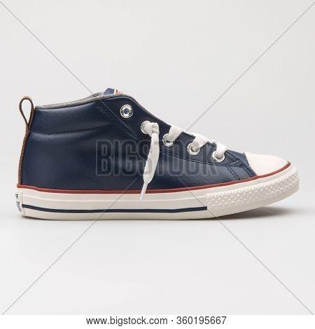 Vienna, Austria - August 14, 2017: Converse Chuck Taylor All Star Street Mid Navy Blue Sneaker On Wh