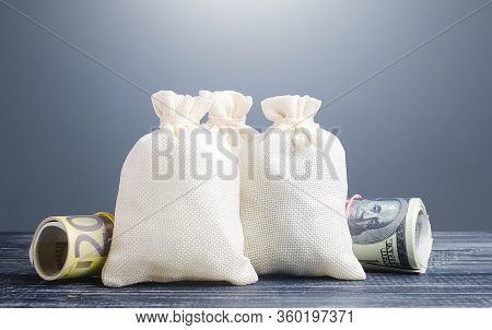 Clear Money Bags. Capital Investment, Savings. Economics, Lending Business. Profit Income, Dividends