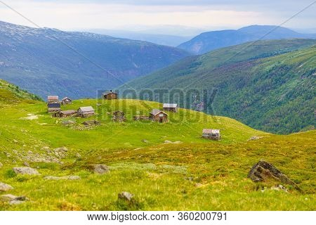 Norwegian Old Houses Hytte, Mountains Farm. Summer Landscape In Norway, Scandinavia
