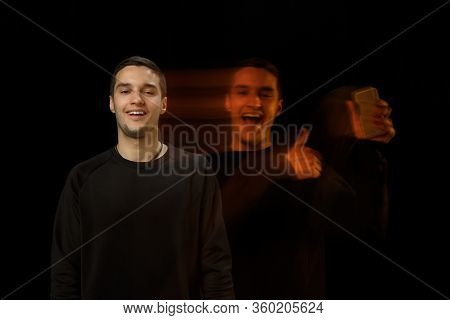 Smiles Outside, Shows Phone Inside. The Versatility Of Man - Opened Emotions And Hidden Feelings. Ca