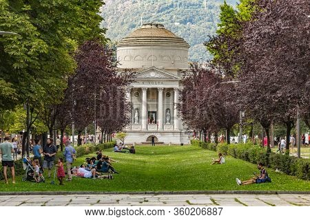 Como, Italy - August 4, 2019: Local People And Tourists On Viale Guglielmo Marconi Near Como Lake. T