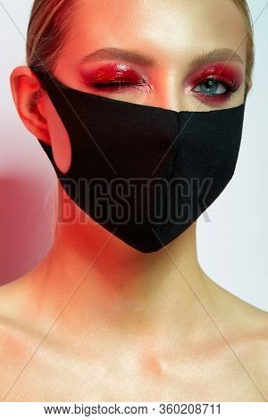 Beautiful Girl With Bright Creative Make-up. Young Model In A Black Mask On Her Face. Coronavirus Pr