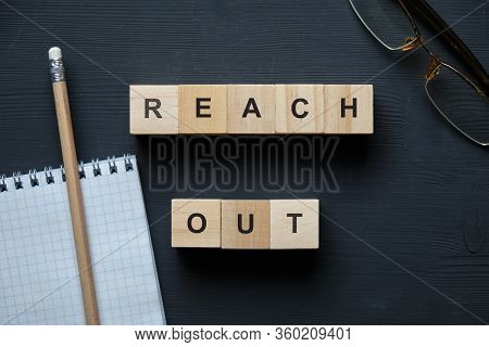 Modern Business Buzzword - Reach Out. Top View On Wooden Table With Blocks. Top View. Close Up.