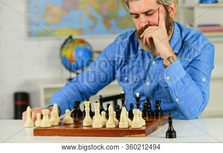 Figures On Wooden Chess Board. Thinking About Next Step. Chess Is Gymnasium Of Mind. Chess Lesson. S