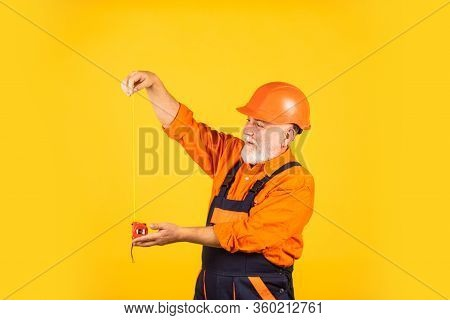 Ready To Work. Engineer Size Measuring. Construction Man Hold Measuring Tape. Engineering And Repair