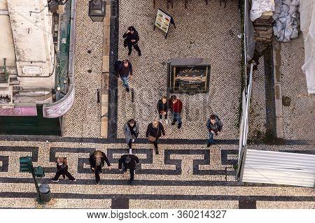 Lisbon, Portugal - 2 March 2020: Top View Of People Walking On Rua De Santa Justa