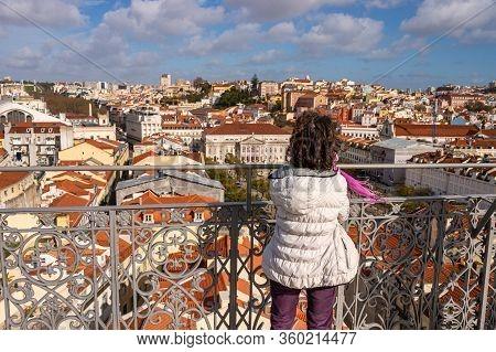 Lisbon, Portugal - 2 March 2020: Woman Looking At The View From Elevador De Santa Justa.