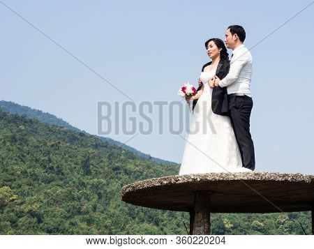 Thua Thien Hue Province, Vietnam - March 13, 2016: Asian Couple Posing For Wedding Photos At The Top
