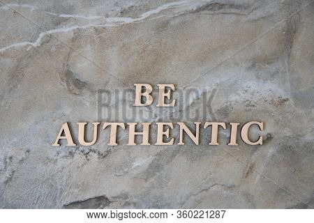 Be Authentic , Writen Wooden Letters On Stone Background