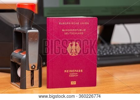 Vinous Biometric Passport Of A German Citizen With A Border Date Stamper, Close-up. Inscription - Eu