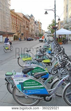 Lodz / Poland. 03 August 2019: View Of City Street With Many Bicycles. City Life In Lodz. Busy Traff