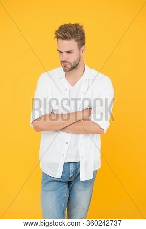 Fashion And People Concept. Sexy And Handsome. Confident Young Handsome Man In Jeans Shirt. Guy Wear