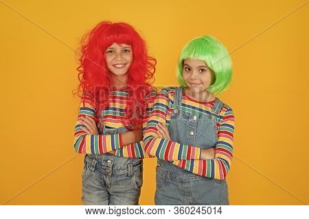 Casual But Luxury. Casual Party Look Of Little Children. Small Girls Wear Colored Hair Wigs In Casua
