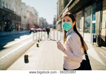 Anxious Young Adult Affected By The Covid-19.walking,going To Work During Pandemic.protective Measur