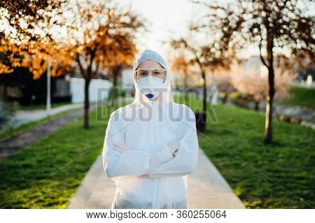 Disinfection Service Worker In Hazmat Suit With N95 Mask And Protective Glasses.private Protective E