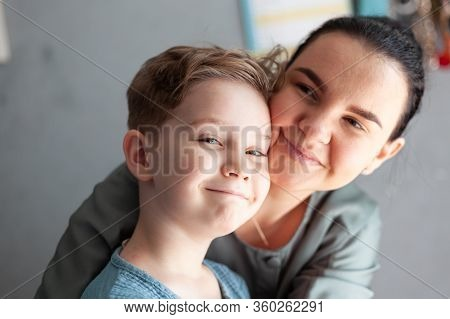 Child With Autism And Down Syndrome Smiles Happily In The Arms Of A Happy Mother Dual Diagnosis