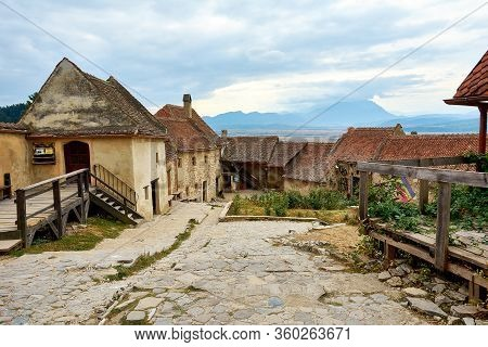 Street Of The Ancient Fortress Town. Medieval Walled City Rasnov On Hill, Romania. Autumn Landscape
