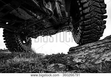 Extreme Off Road Tour In A Forest. Water Splash In Off-road Racing. Off Road Car On Mountain Road
