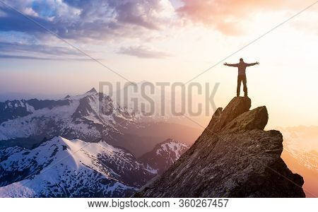 Adventure, Explore And Lifestyle Concept Composite. Adventurous Man Hiker With Hands Up On Top Of A