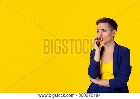 Angry Frustrated Woman Talking On Phone Looking To Copy Space Isolated Yellow Background Wall. Negat