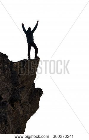 Adventurous Man Hiker With Hands Up On Top Of A Steep Rocky Cliff. White Background Isolated Cutout.