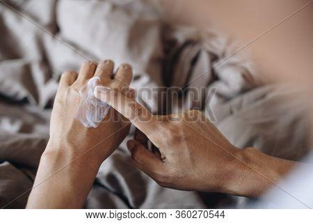 Woman Applying Nourishing Cream On Her Hands ,skin Care