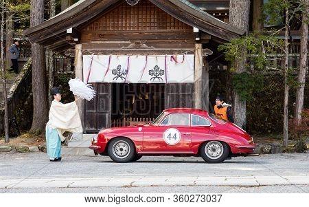 Chino, Nagano Prefecture, Japan - October 22, 2017: Shinto Priest Blessing A Car At Suwa Taisha Kami