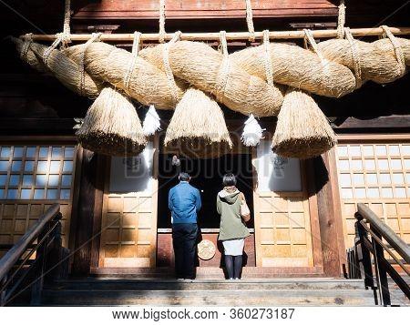 Shimosuwa, Nagano Prefecture, Japan - October 22, 2017: Visitors Praying At Suwa Taisha Shimosha Aki
