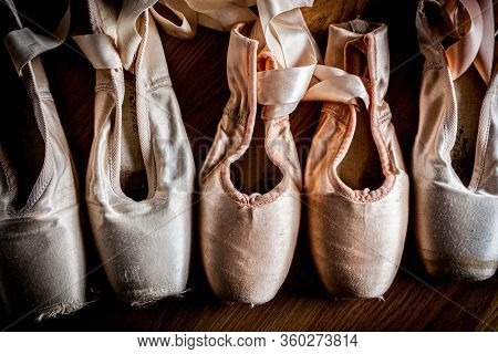 A group of used ballet slipper or pointe shoes
