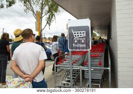 People Queuing At The Grocery During Coronavirus Pandemic