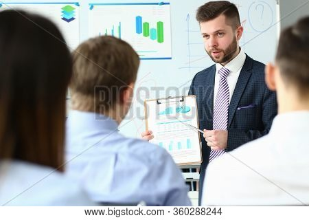 Handsome Bearded Man In Suit And Tie Showing Students Document Clipped To Pad Portrait