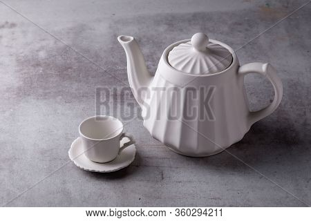 Teapot Creamer, Cup And Saucer On Cement Board