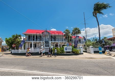 George Town, Cayman Islands, British West Indies - April 23, 2019: Tourists In Front Of The National