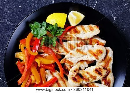 Restaurant Style Grilled Chicken Breast Pieces With Sweet Peppers, Parsley, Lemon Wedges Golden Cutl