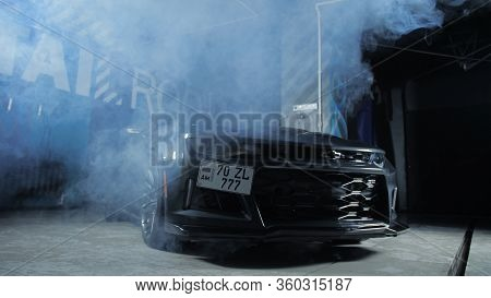 Tomsk, Russia - March 30, 2020: Chevrolet Camaro Zl1 The Exorcist In The Garage With Lights And Smok