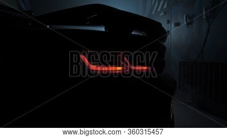 Tomsk, Russia - March 30, 2020: Chevrolet Camaro Zl1 The Exorcist In The Garage Darkness Rear View,