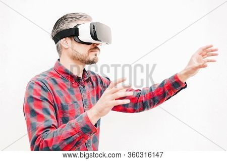 Man In Vr Headset Touching Air. Serious Bearded Man In Checkered Shirt Moving With Hands And Using V