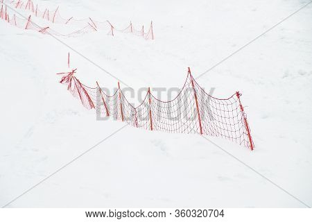 Red Fence In The Snow. Obstruction, Block Occlusion