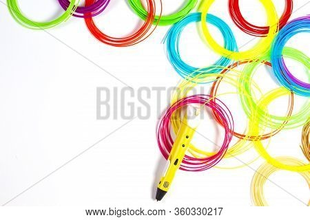 3d Pen With Colourful Plastic Filament On White Background