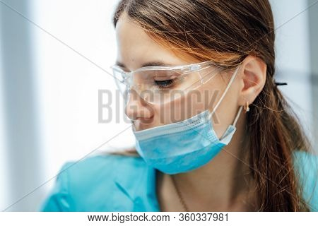 Female Dentist Is Working In Modern Stomatology Clinic. Stomatological Instrument In The Dentist Cli