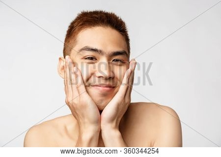 Beauty, Skincare And Men Health Concept. Portrait Of Silly, Adorable Asian Naked Guy, Treating His I