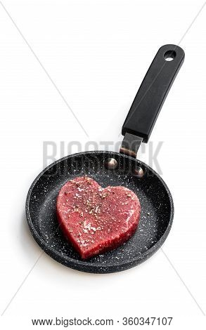 Heart  Shaped Raw Beef Meat With Spices On Small Frying Pan Isolated On White. Healthy Lifestyle Or
