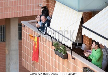 People applaud at eight o'clock in balcony after Spain imposed a lockdown to slow down the spread of the coronavirus disease in Valencia, Spain on April 5, 2020.