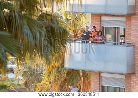 A family applaud at eight o'clock in balcony after Spain imposed a lockdown to slow down the spread of the coronavirus disease in Valencia, Spain on April 5, 2020.