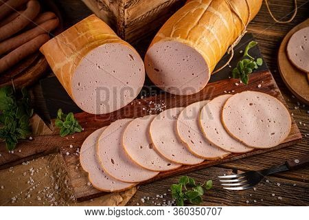 Poultry Cold Cuts Cut Into Slices On Wooden Background