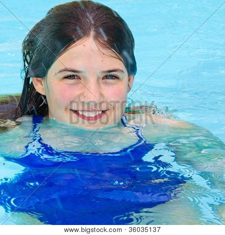 Smiling Girl In Swimming Pool Closeup