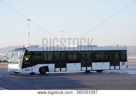 Krakow, Poland 20.12.2019: White Bus Cobus Is Driving Along The Runway At The Airport. Organization
