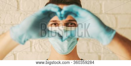 Banner Of Happy Doctor In Medical Face Mask And Protective Gloves Gesturing Heart Shape Sign By Hand